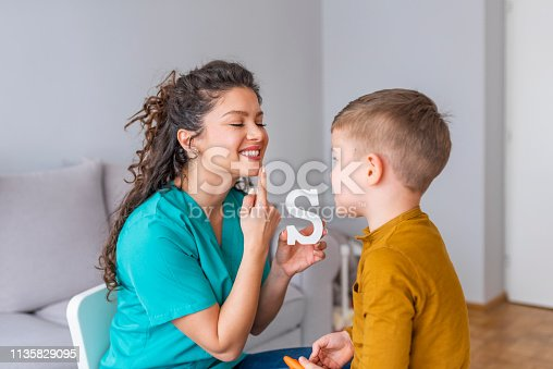 istock Cute little boy at speech therapist office 1135829095