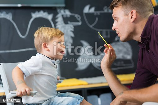 843899350istockphoto Cute little boy at speechtherapist session. 848262700