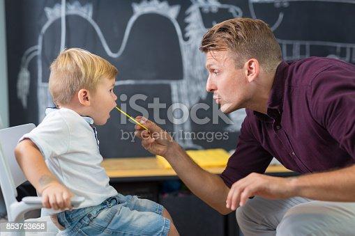 843899350istockphoto Cute little boy at speechtherapist session. 853753658