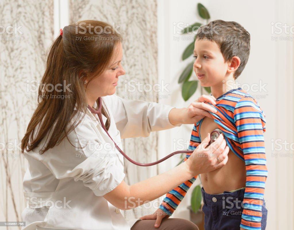 Cute little boy at the pediatrician stock photo