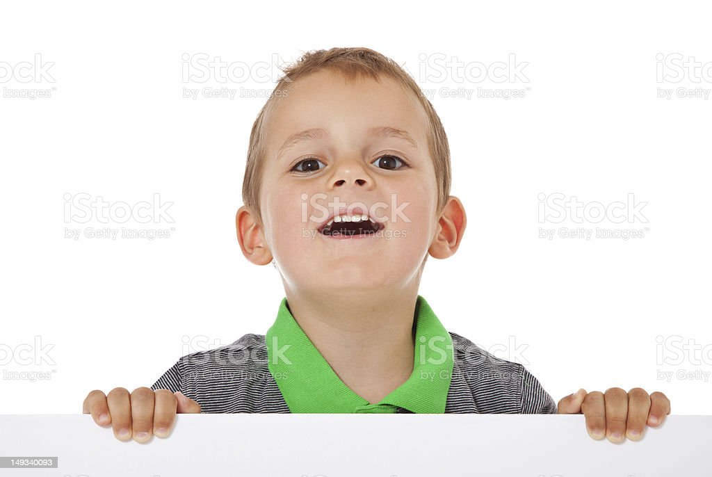 Cute little boy behind white sign royalty-free stock photo