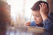 Cute little boy doing his homework