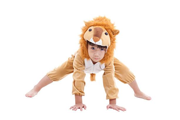 Cute little boy dressed in lion suit stock photo