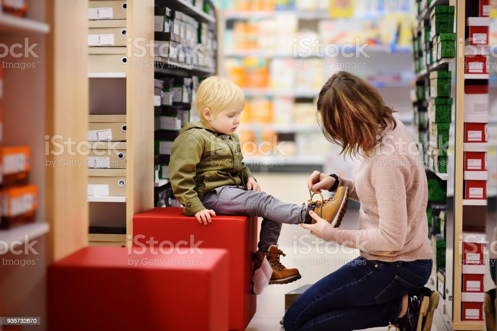 Cute little boy during shopping with his young mother stock photo