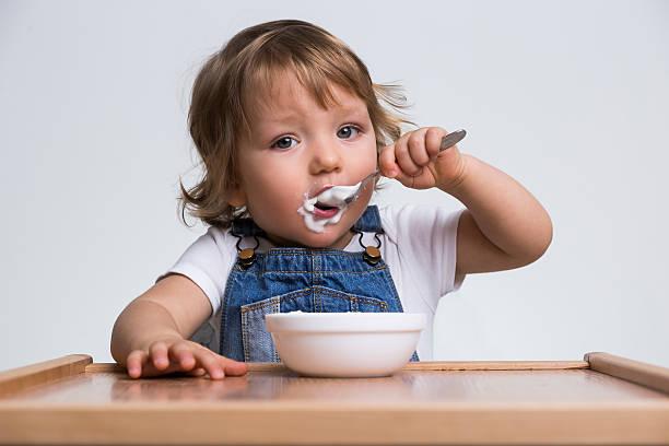 Cute little boy eating porridge – Foto