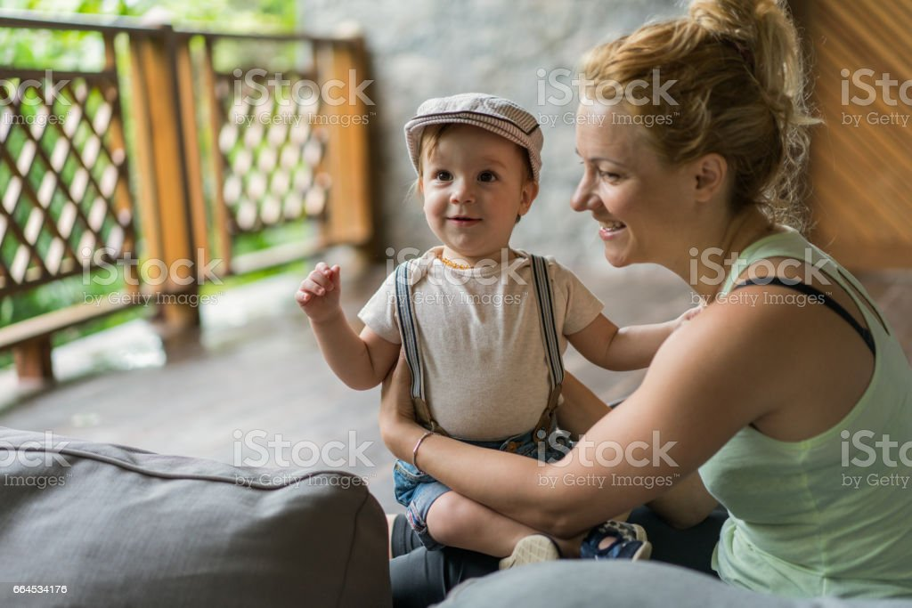 Cute little boy enjoying with his mother on a terrace. royalty-free stock photo