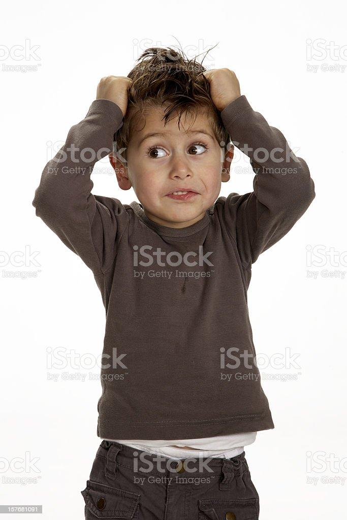 Cute little boy fun tearing hair studio shot on white stock photo