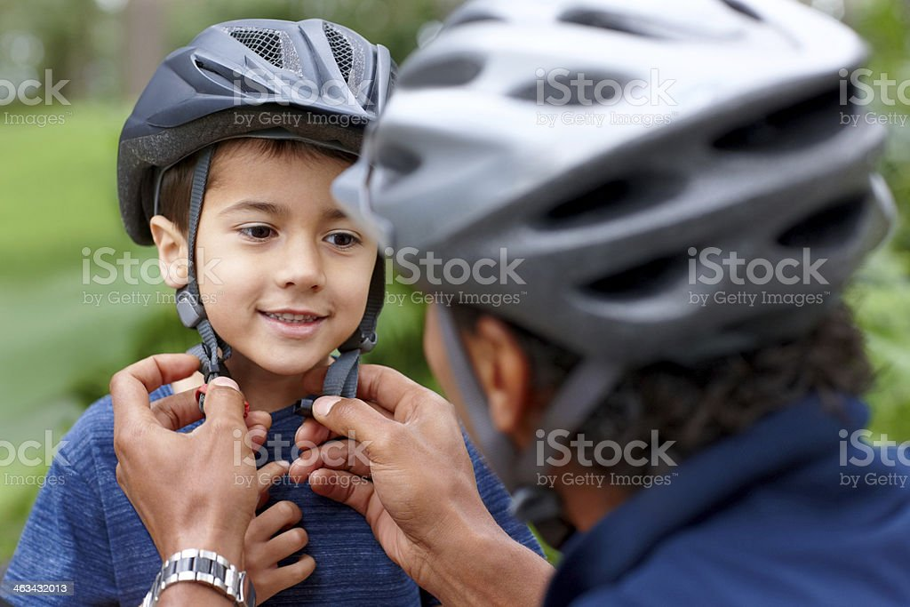 Cute little boy getting ready for bicycle ride stock photo