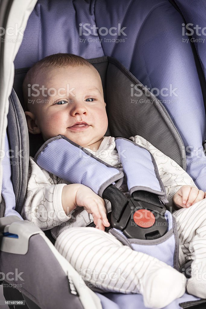 Cute little boy in car seat royalty-free stock photo