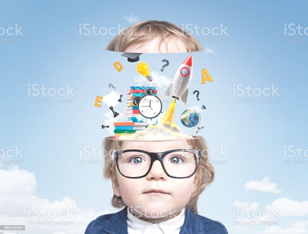 Cute little boy in glasses, start up in the sky zbiór zdjęć royalty-free