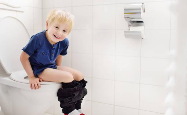 Cute little boy in restroom stock photo