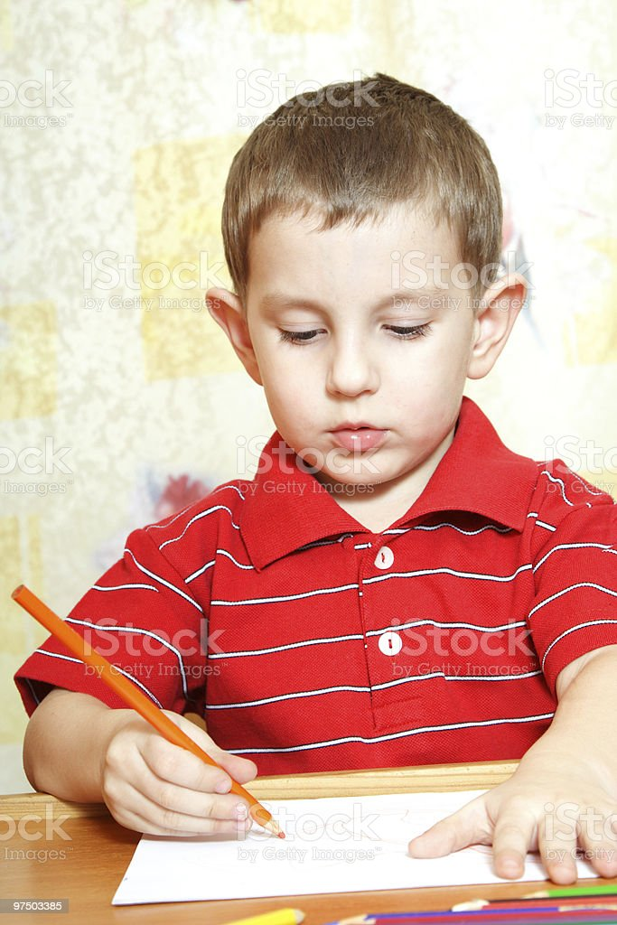 Cute little boy is drawing royalty-free stock photo