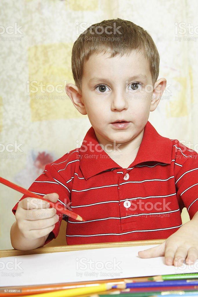 Cute little boy is going to draw royalty-free stock photo