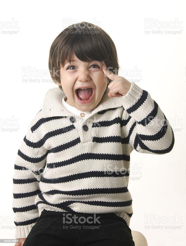 cute little boy joyfully points his head royalty-free stock photo