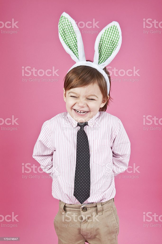 Cute Little Boy Laughing and Wearing Bunny Ears stock photo