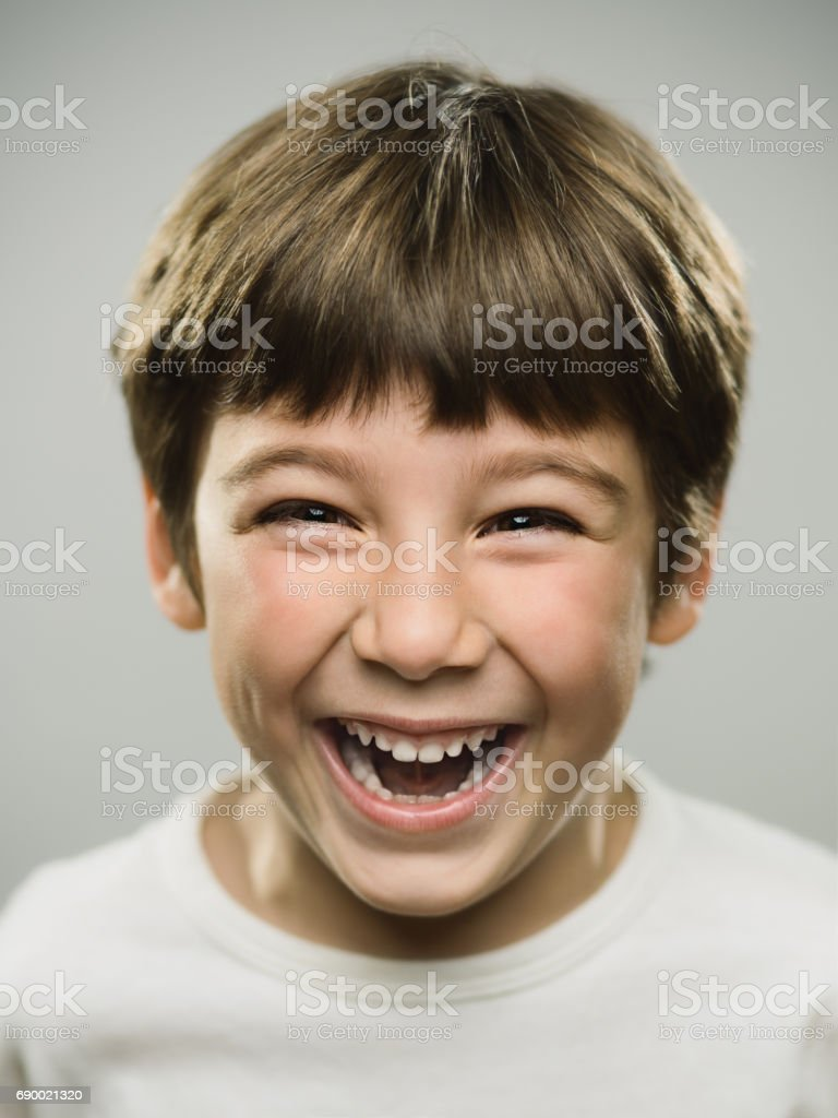 Cute little boy laughing in studio - foto stock