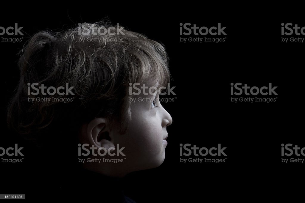 Cute little boy looking forward stock photo