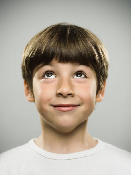 Cute little boy looking up stock photo