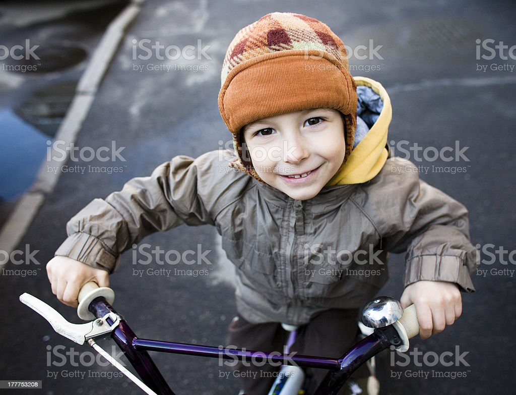 cute little boy on bycicle royalty-free stock photo