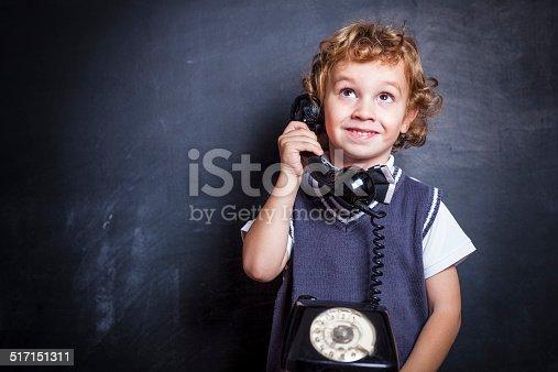 istock Cute little boy on the phone 517151311