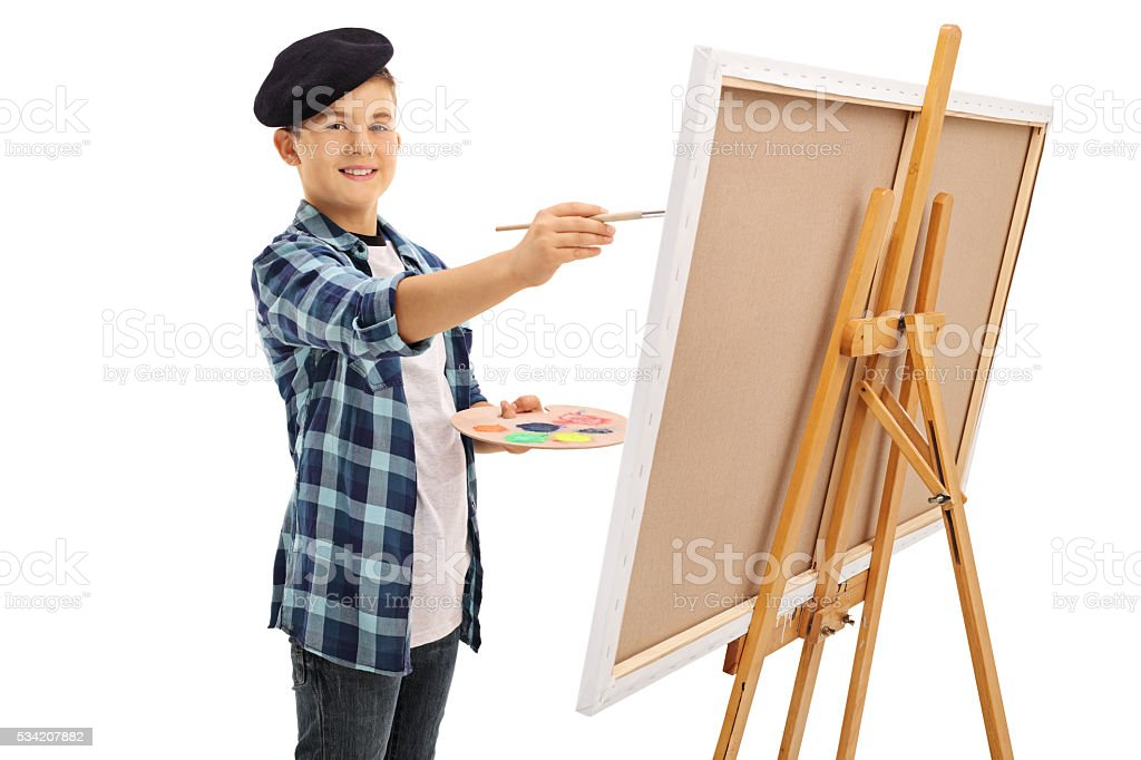 Cute little boy painting on a canvas stock photo
