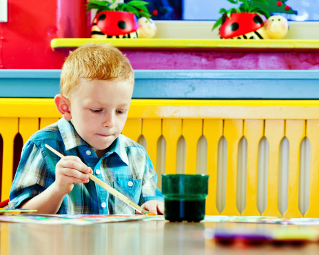 Cute Little Boy Painting Stock Photo - Download Image Now