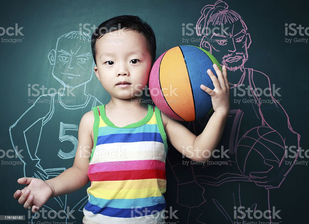 cute little boy playing basketball royalty-free stock photo