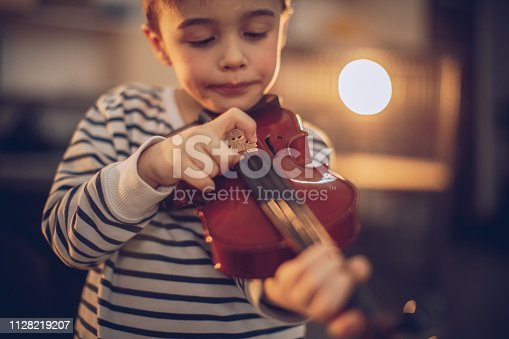 One young boy playing violin.