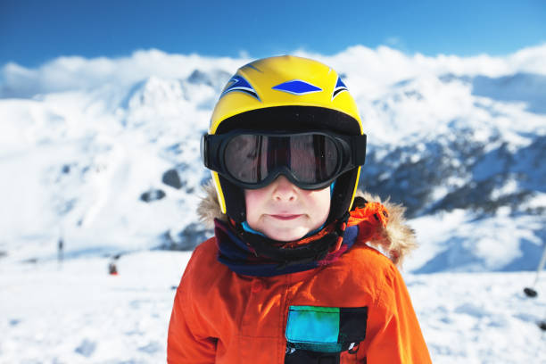 Cute little boy posing on camera in Andorra ski resort stock photo