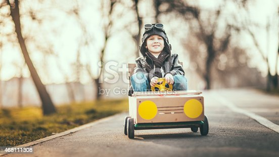 959599892 istock photo Cute little boy racing in a vintage go kart 468111308