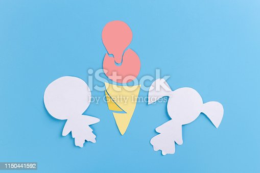 958492394 istock photo Cute little boy share ice cream with his sister 1150441592