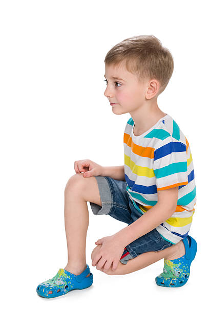 Cute little boy sits on the white – Foto