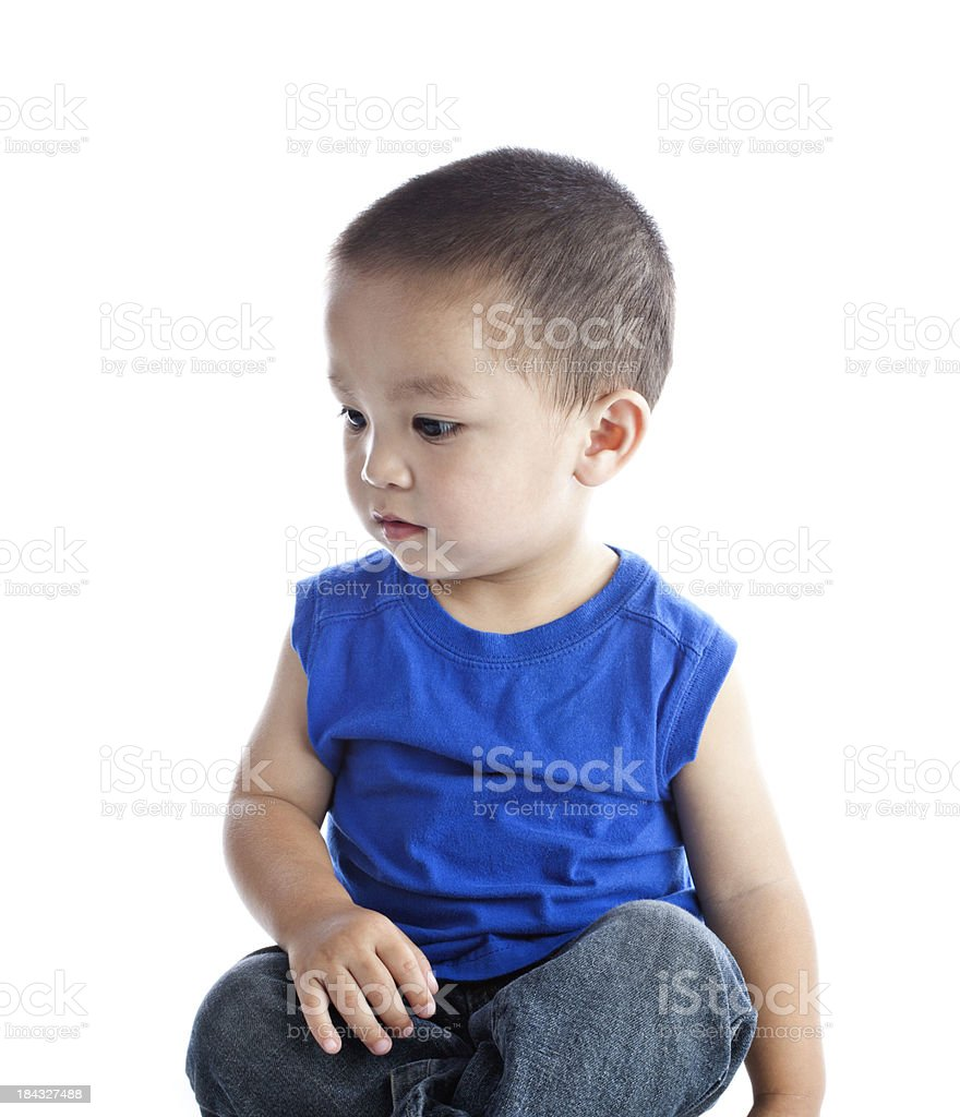 a370a45660d Cute little boy sitting on an isolated white background royalty-free stock  photo