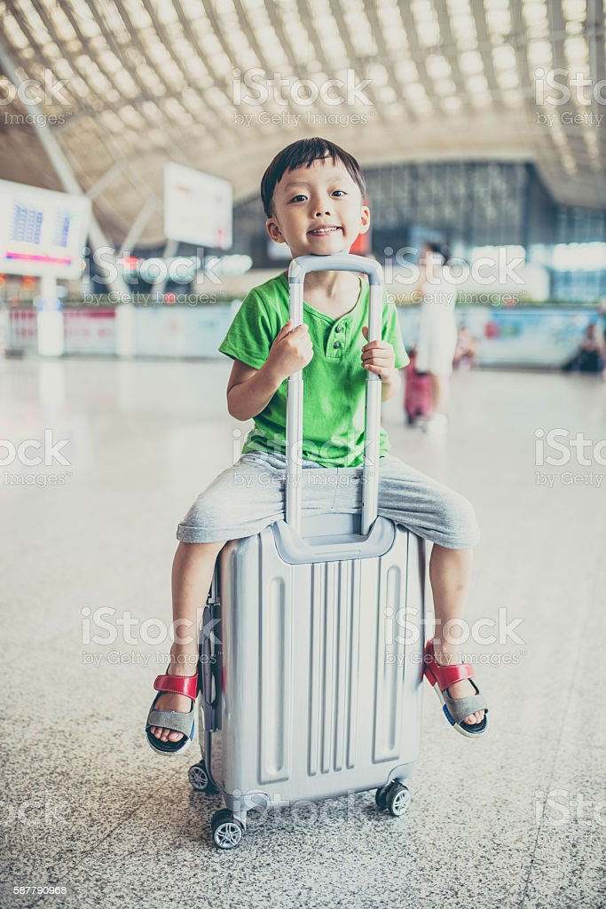 Little Boy And Toddler Girl Sitting On Suitcases Ready To ...  Little Boy Traveling