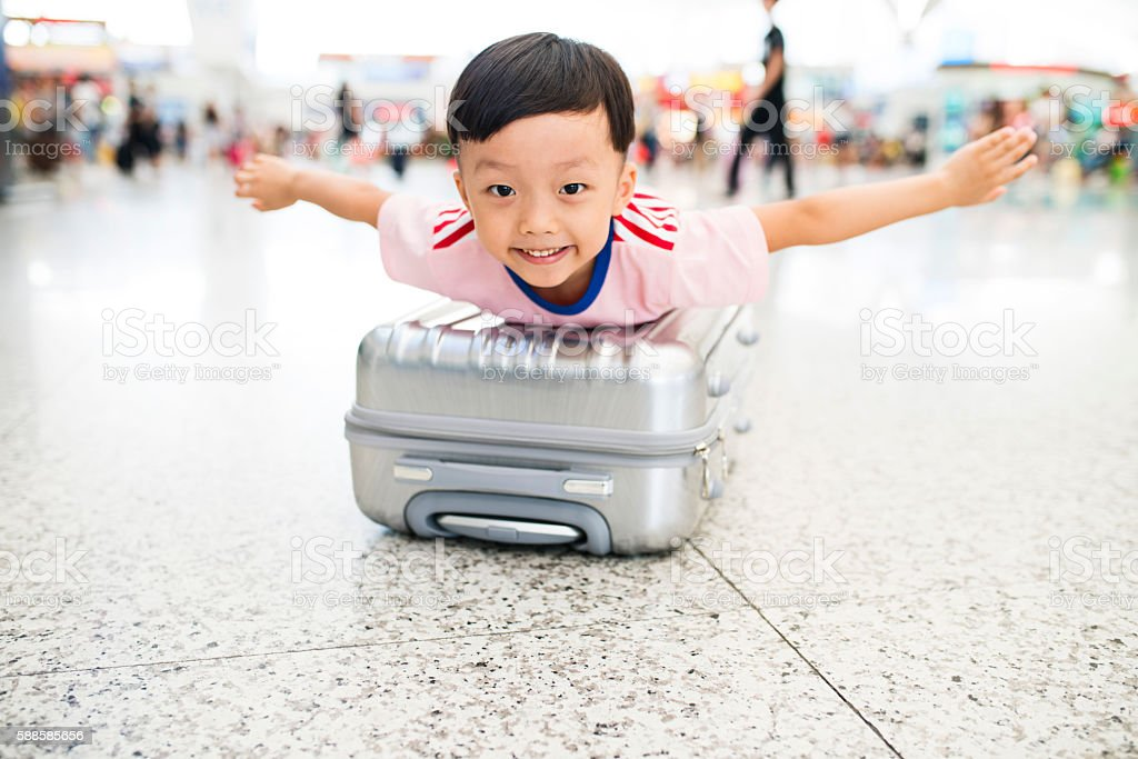Cute little boy waiting in the airport, child travel stock photo