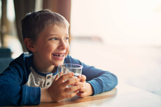 cute little boy water - drinking water stock photos and pictures
