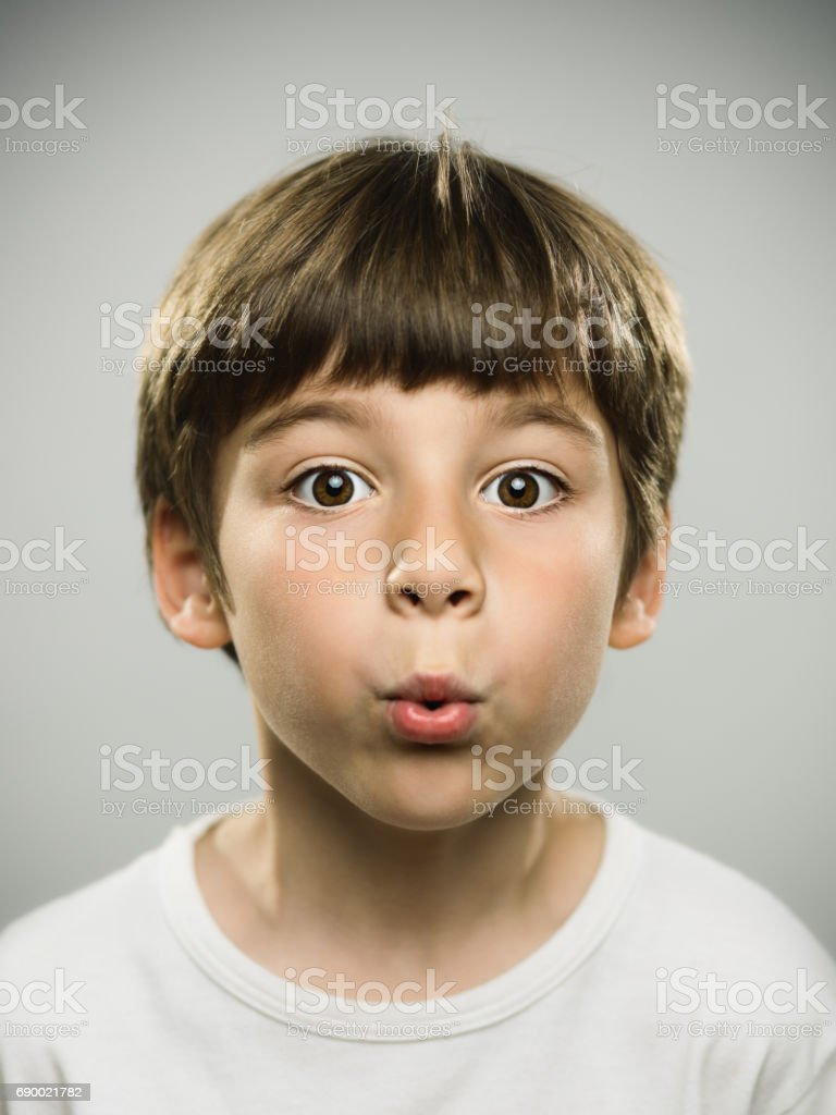 Cute little boy whistling stock photo