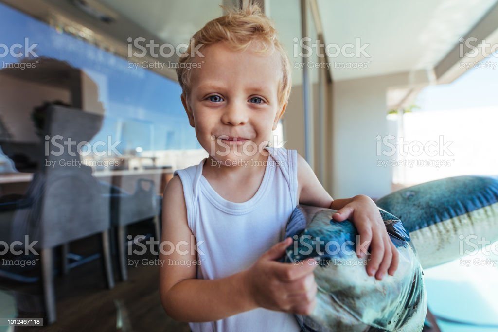 Cute little boy with a inflatable toy stock photo