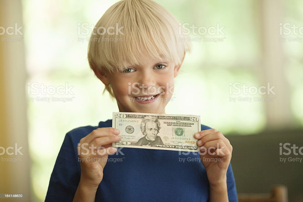 Cute Little Boy With A Twenty Dollar Bill stock photo