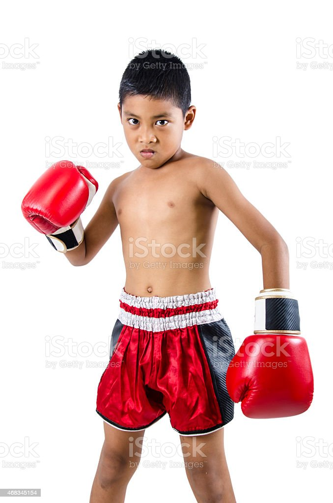 cute little boy with boxing gloves stock photo