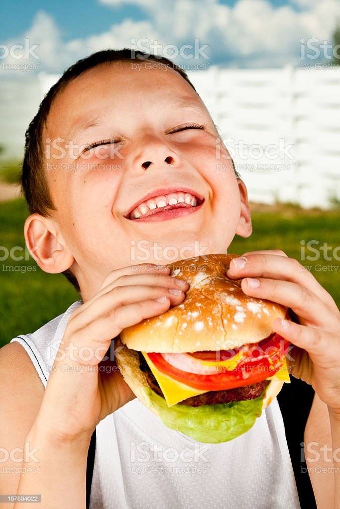 Cute Little Boy with Hamburger royalty-free stock photo