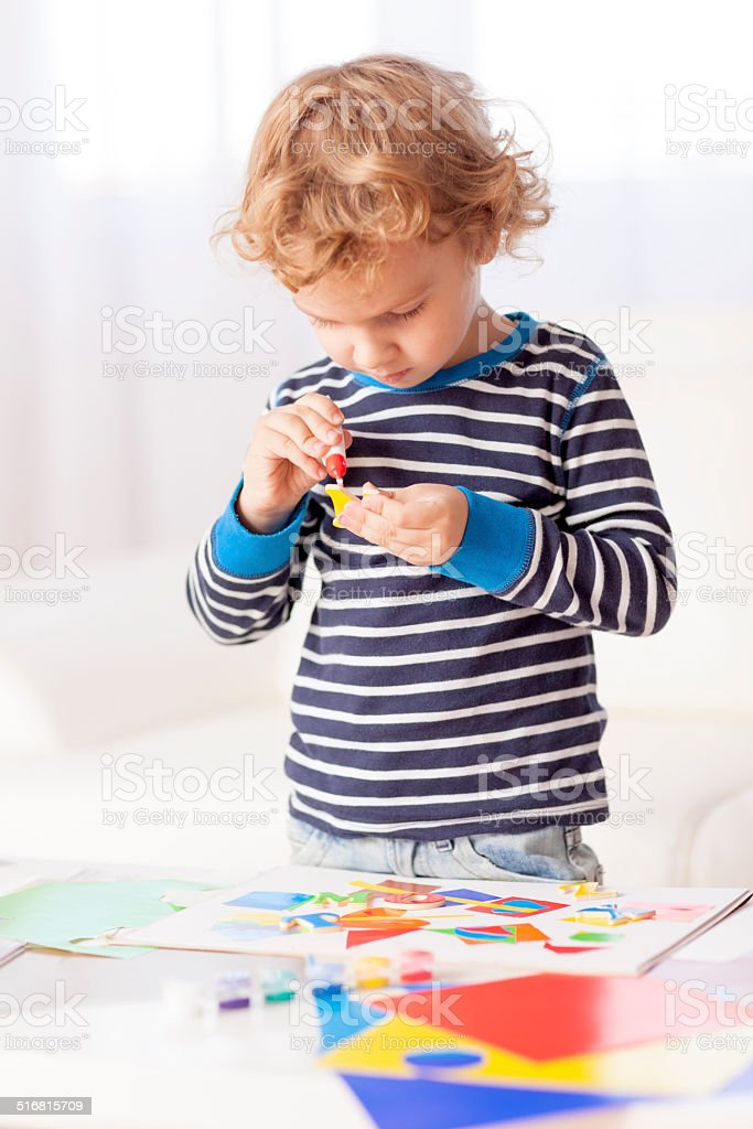 Cute little boy with his art and craft project