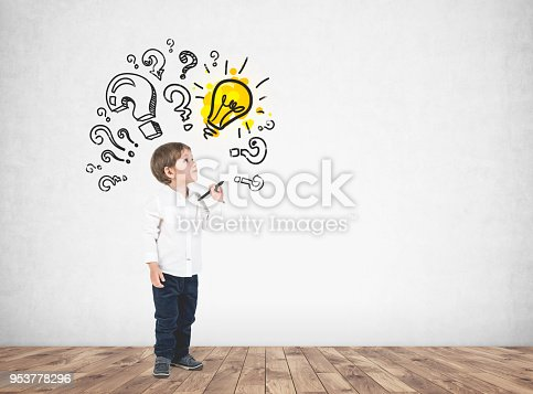 istock Cute little boy with marker, question marks, idea 953778296