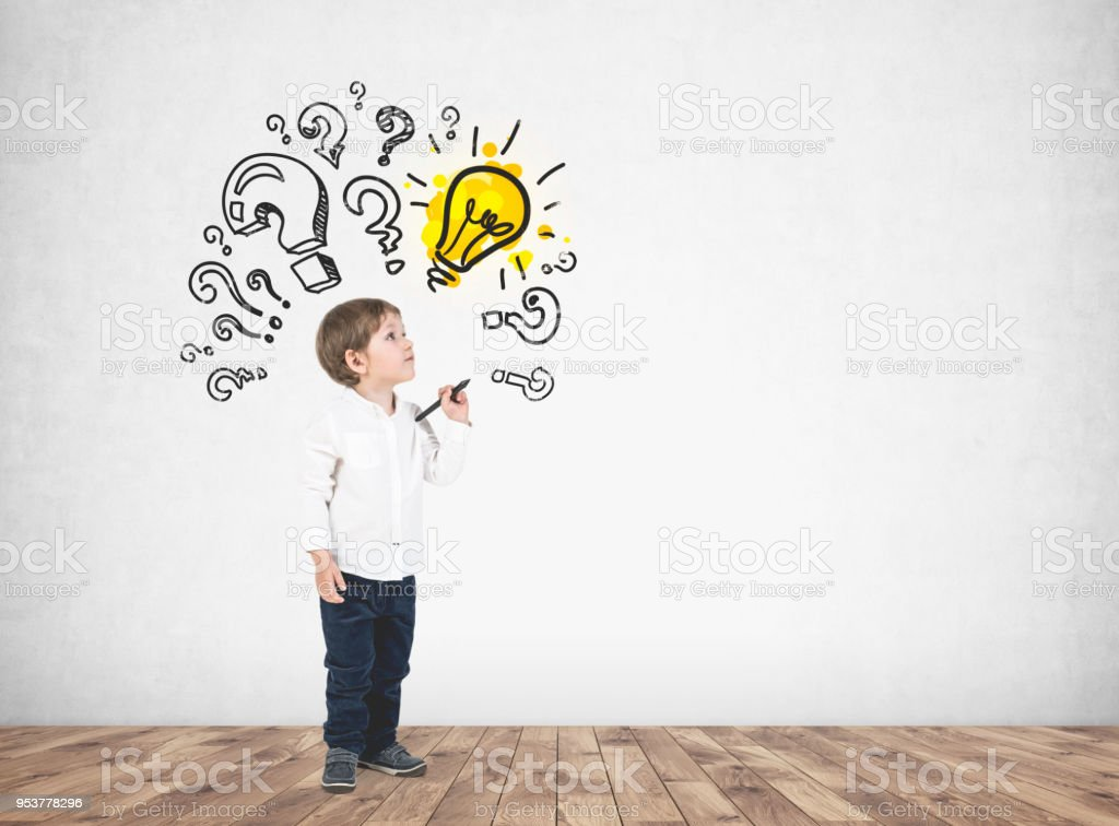 Cute little boy with marker, question marks, idea stock photo