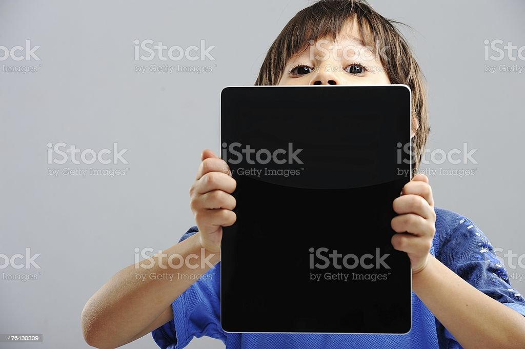 Cute little boy with Tablet PC royalty-free stock photo