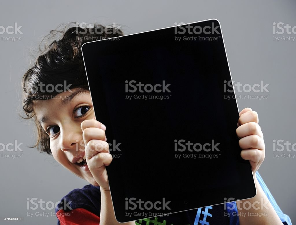 Cute little boy with Tablet PC stock photo