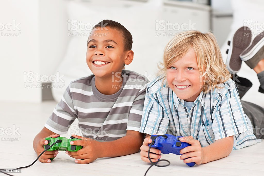 Cute little boys playing with a video game royalty-free stock photo