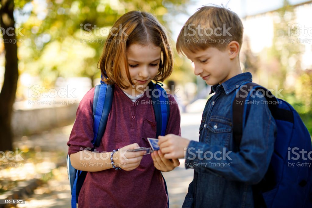 Cute little boys playing with cards stock photo
