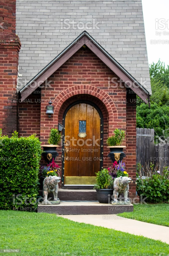 cute little brick cottage entrance decorated for party with beads on