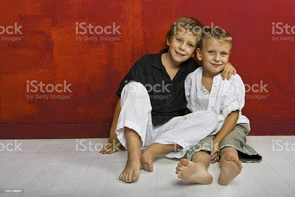 Cute little brothers together stock photo